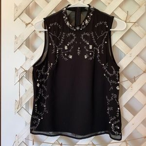 Black tank top with beaded details.